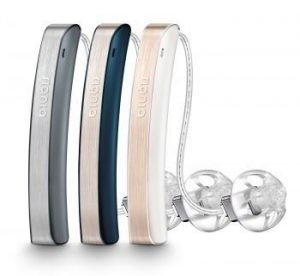 Three Signia Styletto hearing aids in rose gold, cosmic blue, and dark granite