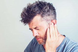 Man in pain due to tinnitus